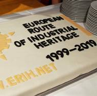 """Cake commemorating the 20th anniversary of ERIH, bearing the inscription """"European Route of Industrial Heritage 1999-2019"""" plus logo and internet address www.erih.net"""